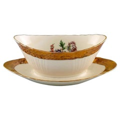 Royal Copenhagen Porcelain Sauce Boat with Floral Motifs and Gold Border