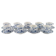 Royal Copenhagen, Set of Nine Blue Fluted Plain Coffee Cups with Saucers