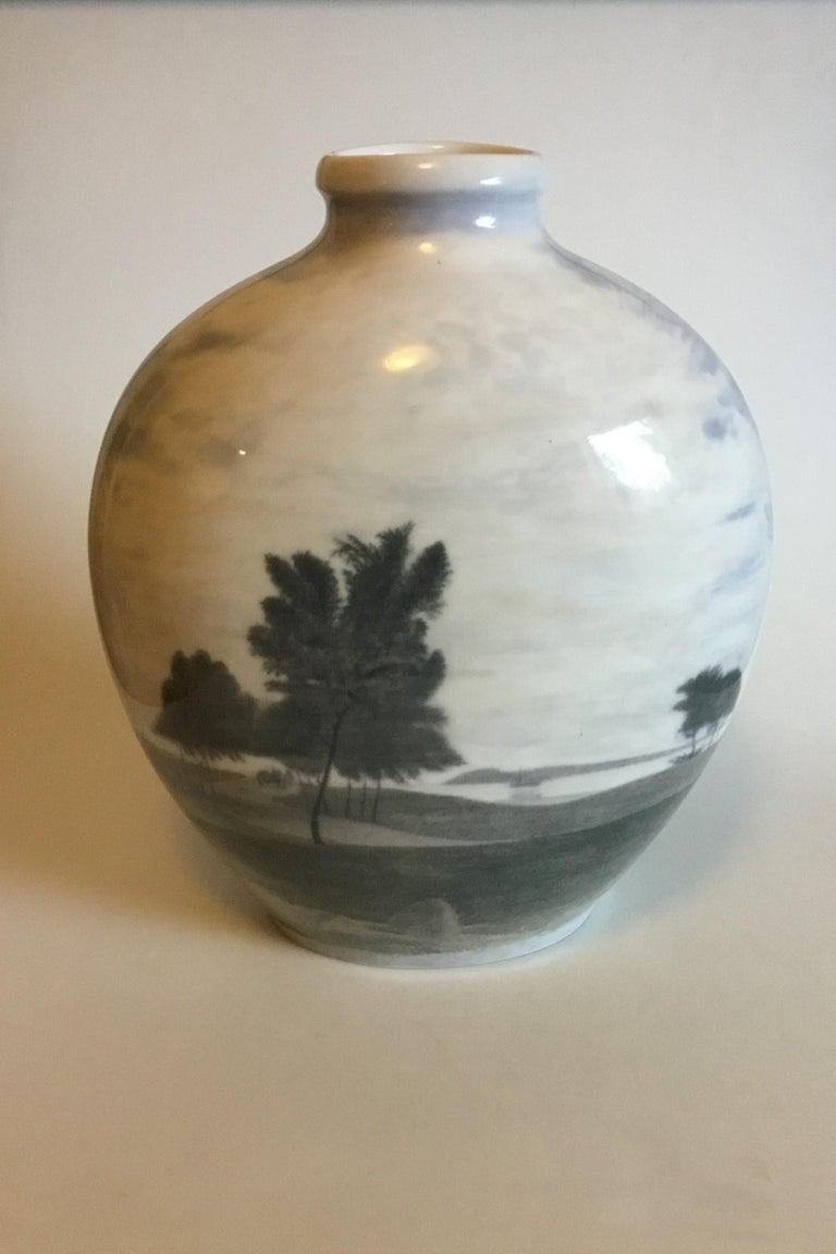Royal Copenhagen Unique Vase by Karl Sørensen from November 14th 1923 with motif of Windmill and Landscape.   Measures 39 cm / 15 23/64 in.   Is in good condition.