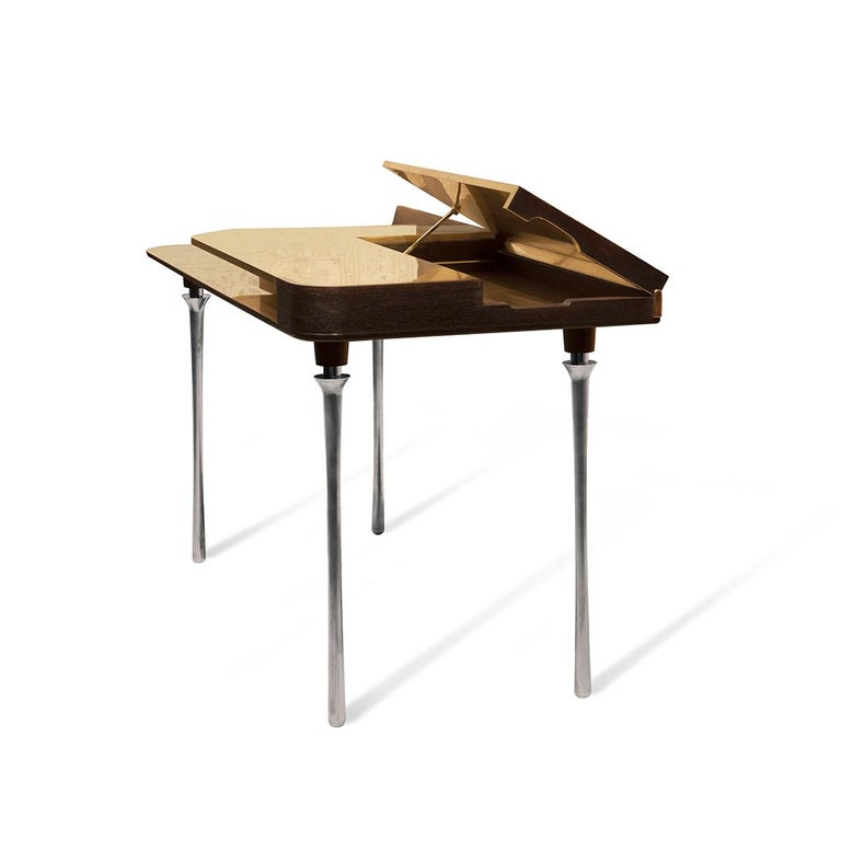 Invite the Royal Desk into your space to create a regal yet functional home office environment. Its silver plated solid brass legs, hand varnished wood body and polished brass top complete with grand piano styled drawer will leave you in awe of its