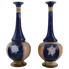 Royal Doulton, England, a Pair of Narrow-Necked Art Nouveau Vases