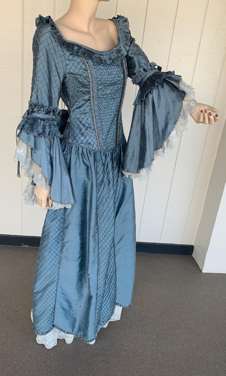 Fine quality, custom made, Marie Antoinette style ballroom evening gown or long dress is exquisitely made out of a rich blue gray colored raw silk or silk noil and has a somewhat rough texture (characteristic of this type of silk) and a graceful
