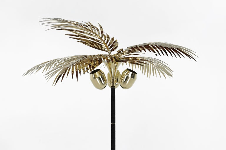The Royal palm floor lamp is a celebration of living and creating in Los Angeles for almost two decades. The palm tree is as much a sculpture as it is a floor lamp. The body is made of stacked saddle leather, brass, all hand-sculpted and polished.