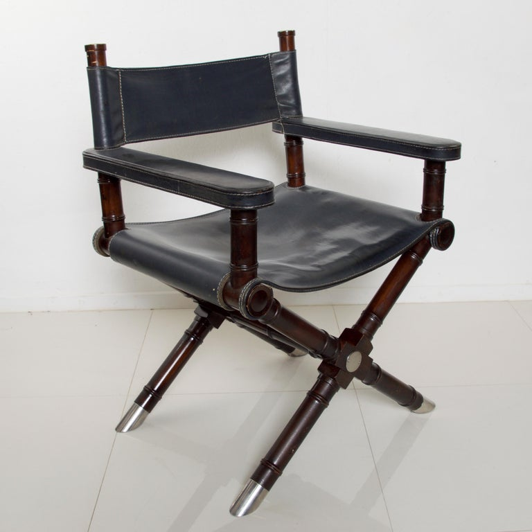 Presenting Ralph Lauren Leather Hollywood Director's Chair Vintage in Classic Navy Blue Equestrian inspired European Leather Seat on Exotic Rich Wood Cross Braced Mahogany X Frame with Standout Chrome Leg Sabots. Fabulous comfort and style-a