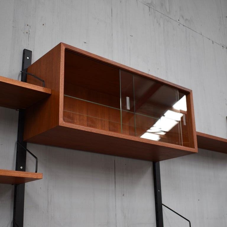 Metal Royal Series Wall Unit by Poul Cadovius in Teak, Denmark, 1950s For Sale