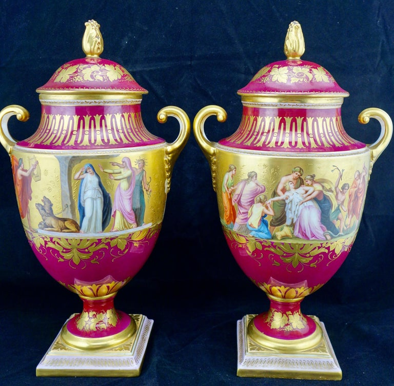 Royal Vienna pair of finely hand painted and background gilded covered vases. The vases are in neoclassical style, depicting the scenes from the legends of Orpheus and Eurydice. Each scene is annotated in German on the bottom of the corresponding