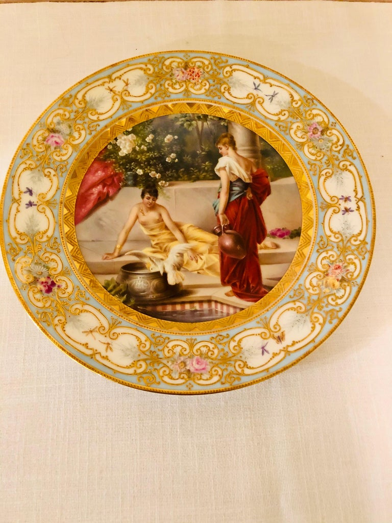 Hand-Painted Royal Vienna Plate Painted with Two Ladies and a Bird at a Tiled Watering Hole For Sale
