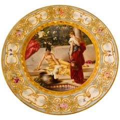 Royal Vienna Plate Painted with Two Ladies and a Bird at a Tiled Watering Hole