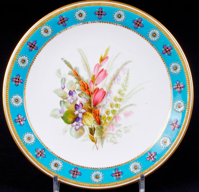 Botanical set of Royal Worcester: consist of compote and 10 plates, each plate has a unique hand painted floral wildflower design. The plates are further enhanced by an enamel turquoise border featuring raised gold beading and raised white and mauve