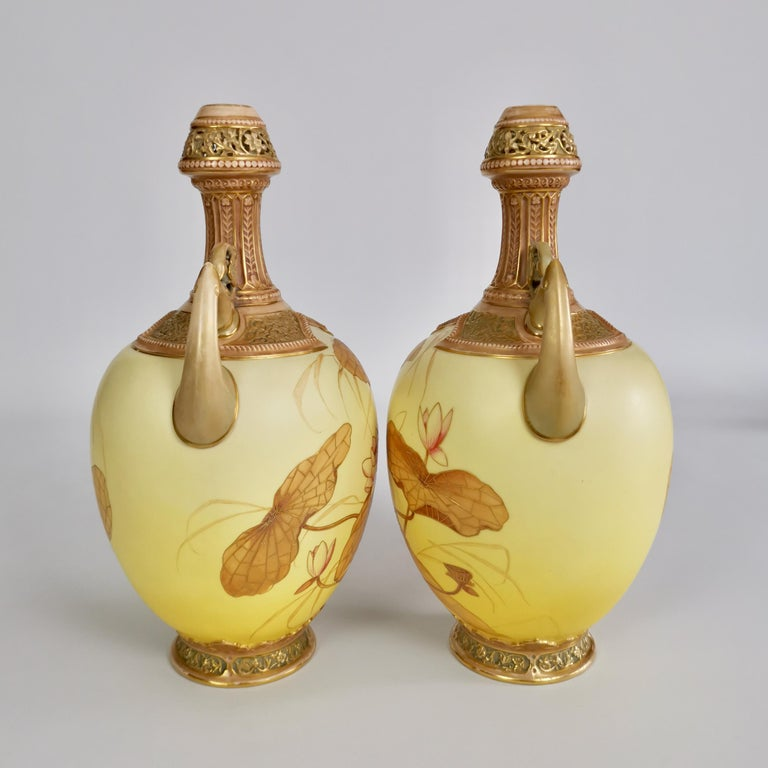 This is a superb pair of vases made by Royal Worcester in the year 1890. The vases are shaped in the Persian style and have a blush ivory Japanese lotus decoration.  The original Worcester factory was founded in the mid-18th century and belongs to