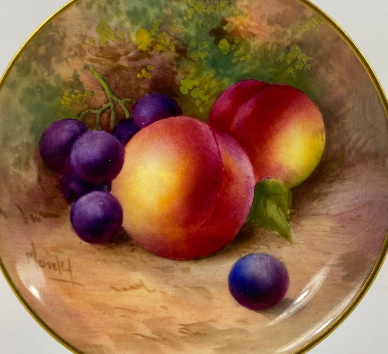 Royal Worcester porcelain pin dish, dated 1936. Finely painted by George Moseley, with a study of fruit, on a mossy bank, within a gilt rim. Signed, Moseley. Printed puce factory mark, and date code for 1936. Medium: Porcelain Width 9 cm, 3
