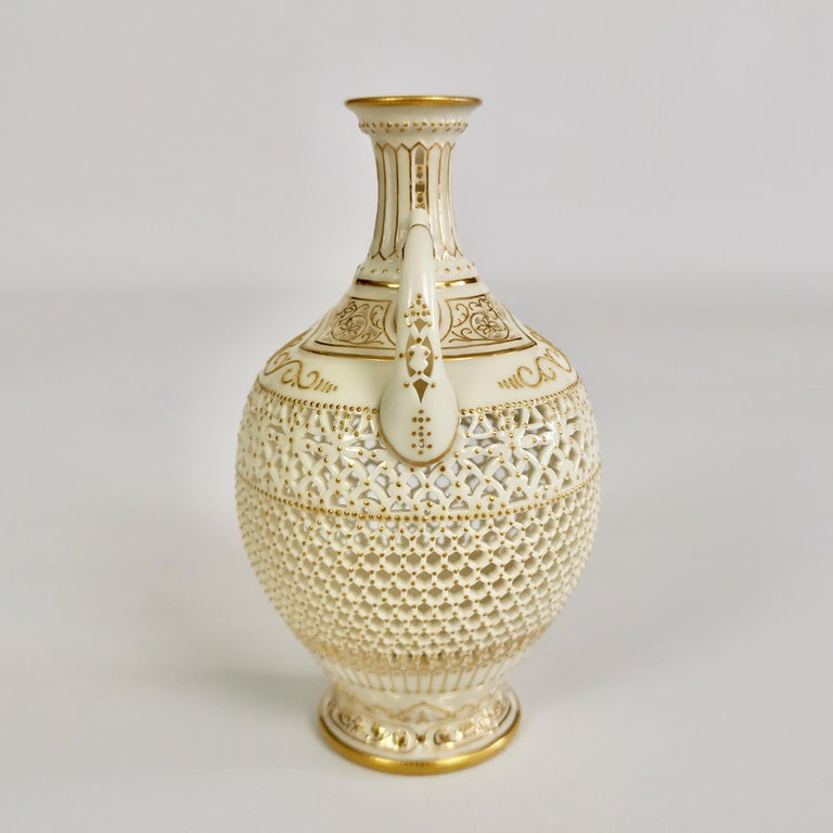 This is an important and sublimely made little vase created by George Owen at Royal Worcester in the year 1917. The vase is in the Persian style and is delicately reticulated (pierced) with very fine raised gilt patterns.  The original Worcester