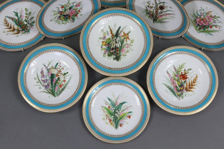 A late Victorian 9-piece part dessert service comprising of a tall comport; a pair of low comports; & 6 plates each with a different floral splay decoration to the centre. Handpainted with polychrome flowers to the central reserve.  Size:  8¾'