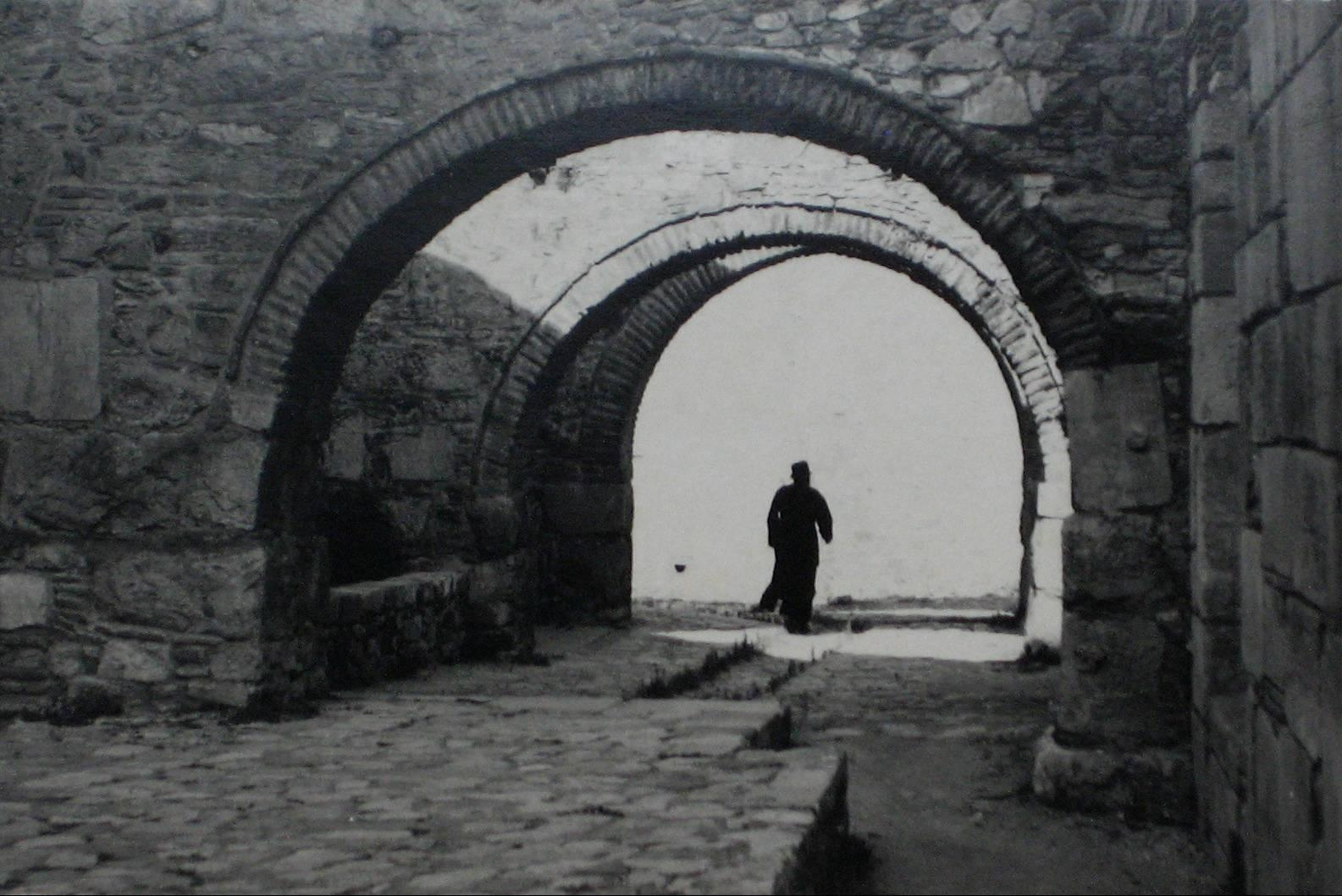 Man on City Streets, Yugoslavia, Black and White Photograph, 1960s