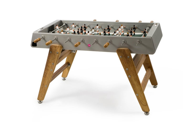 RS #3 wood football table pits black jerseys against white on a black field. Players are based on a vintage design with splayed legs which allows for better ball control and finesse.