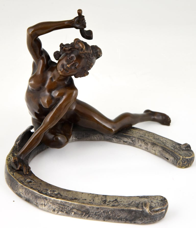 Art Nouveau bronze sculpture of a nude sitting on a horseshoe. The bronze is signed by the French artist Geroges Récipon and stamped by the founder Susse Freres. The bronze has a lovely patina. This model exists in two sizes, this is the largest