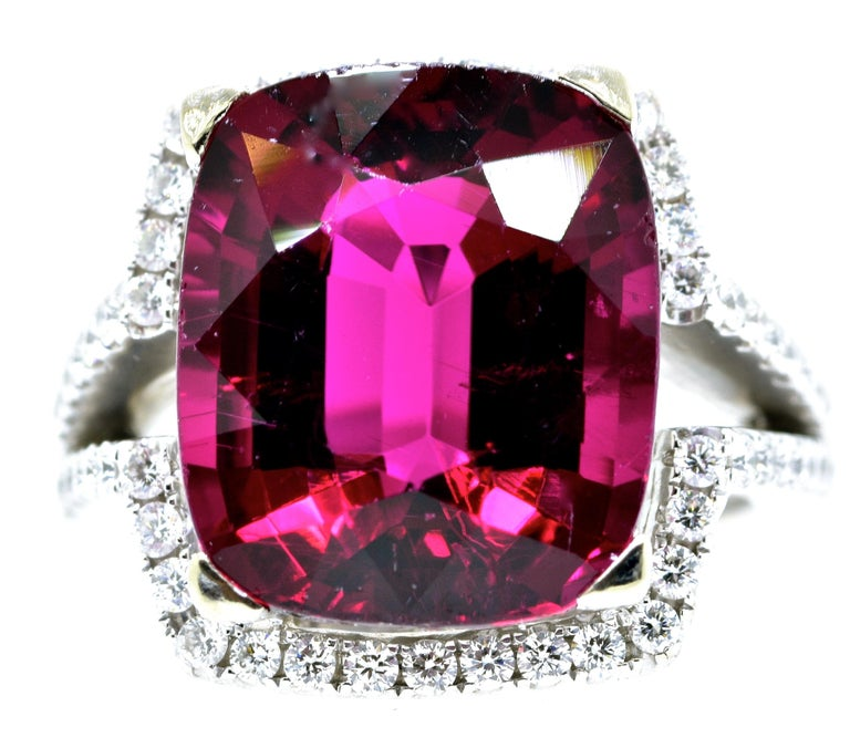 Rubelite is very fine and weighing 13.0 cts., exactly.  It displays a fine pure vivid red color, has fine clarity and a pleasing shape.  The color is a vivid raspberry, with fine clarity with no
