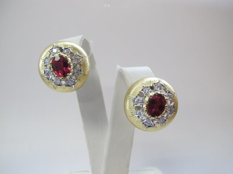 Sophisticated style best describes these Florentine style earrings. They feature 2 cranberry-pink rubellite tourmalines (8x6mm /7.92 carats total weight) and 16 round brilliant cut diamonds weighing .66 carats total. They are made as pierced, French