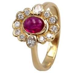 Rubis Cabochon and Diamond 18kt Halo Ring
