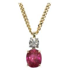 Ruby 3.18 Carat, Diamond 0.40 Carat Gold Pendant