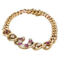 Ruby and Diamond 9 Karat Yellow Gold Horseshoe Link Bracelet