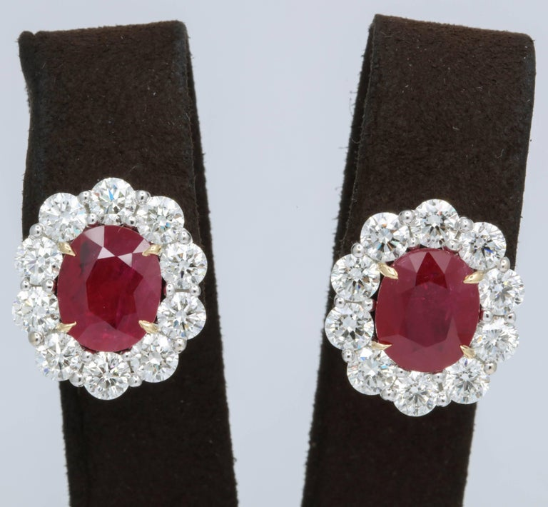 Stunning Ruby and Diamond Earrings!  8.44 carats of intense red ruby  5.58 carats of white round brilliant cut diamonds  18k gold   Approximately .75 inches long and .65 inches wide.   An important looking but wearable ruby and diamond earring.