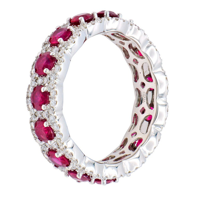This Ruby and Diamond eternity band is a full circle of beauty and elegance. This band contains 15 deep red rubies totaling 2.57 carats surrounded by 150 round VS2, G color diamonds totaling 0.66 carats. They are set in 4.3 grams of 18 karat white