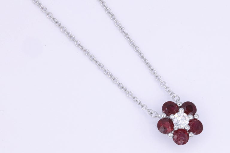 18K white Gold 5 Ruby 0.95 cts. 1 round Diamond 0.13 cts It comes with a chain