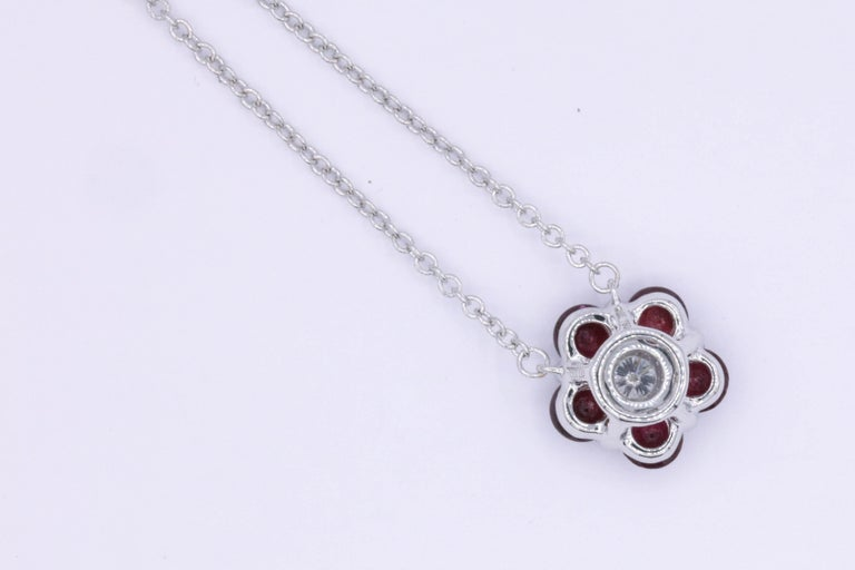 Contemporary Ruby and Diamond Flower Pendant For Sale