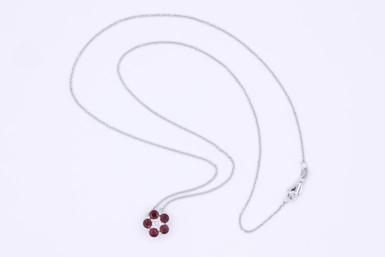 Round Cut Ruby and Diamond Flower Pendant For Sale