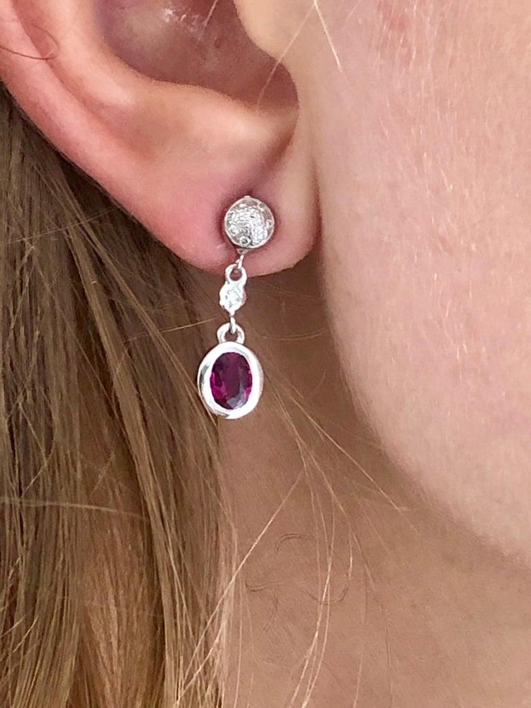 Fourteen karat white gold diamond and ruby earrings measuring 1