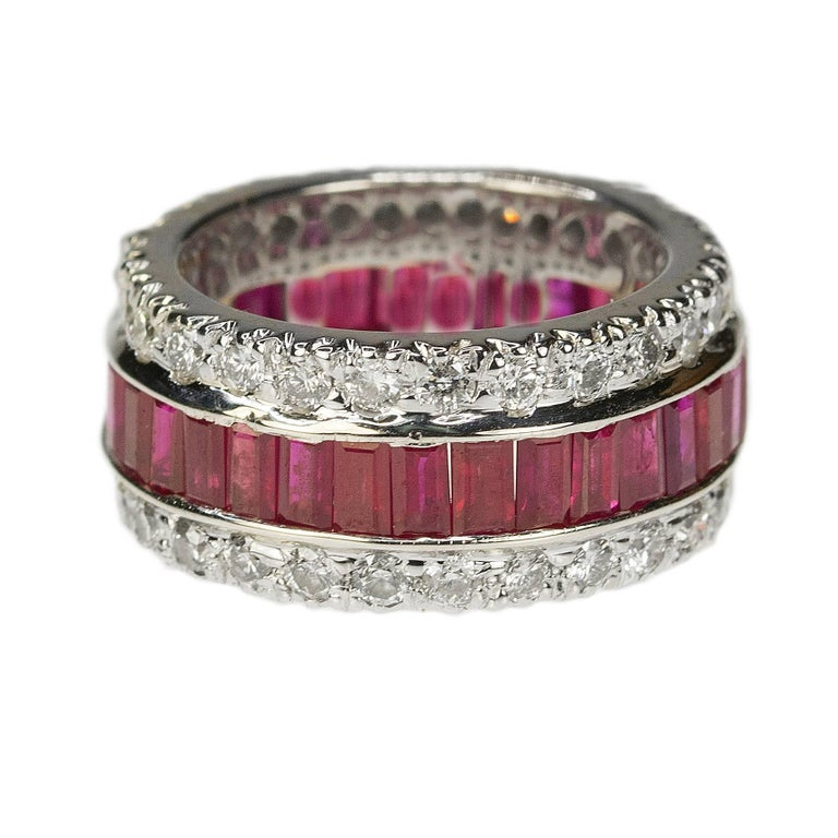 18k white gold Ruby & Diamond Eternity Band with 33 emerald cut rubies weighing approximately 4.25 carats and 54 modern round brilliant diamonds weighing approximately 2.16 carats, 11.58g