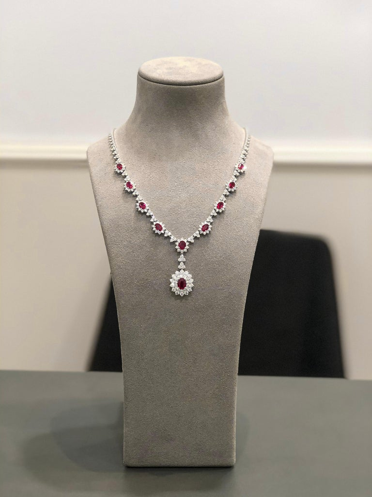 Contemporary Ruby and Diamond Halo Drop Pendant Necklace For Sale