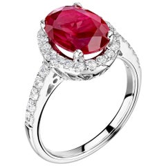 Ruby and Diamond Halo Ring in Platinum