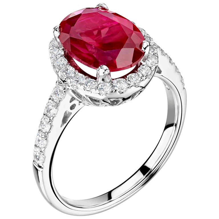 Ruby and Diamond Halo Ring in Platinum For Sale