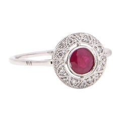 Ruby and Diamond Round Halo Ring in 18 Carat White Gold
