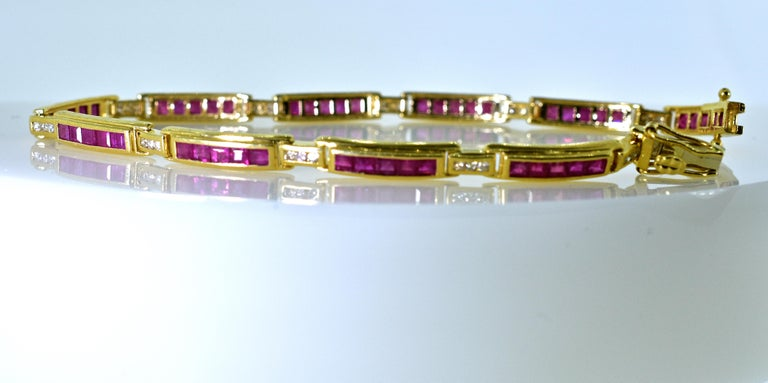 Ruby and diamond straight-line bracelet with 50 fine natural rubies weighing approximately 3 cts., and interspersed with 30 round brilliant cut diamonds weighing approximately .30 cts.  The Rubies are a bright red, and the diamonds are all near