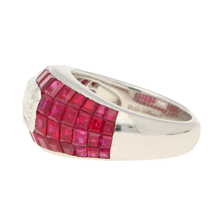 A breathtaking ruby and diamond bombé cocktail ring, set in platinum.   This spectacular piece is designed in a bombé design and is invisibly set throughout with square cut rubies. All of the rubies have been perfectly matched in colour and
