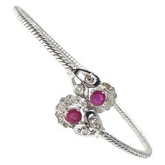 Ruby and White Round Brilliant Diamond Flexible Bangle in 18 Karat White Gold