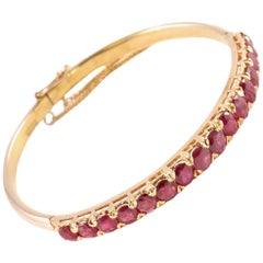Ruby Bangle in 14 Karat Yellow Gold