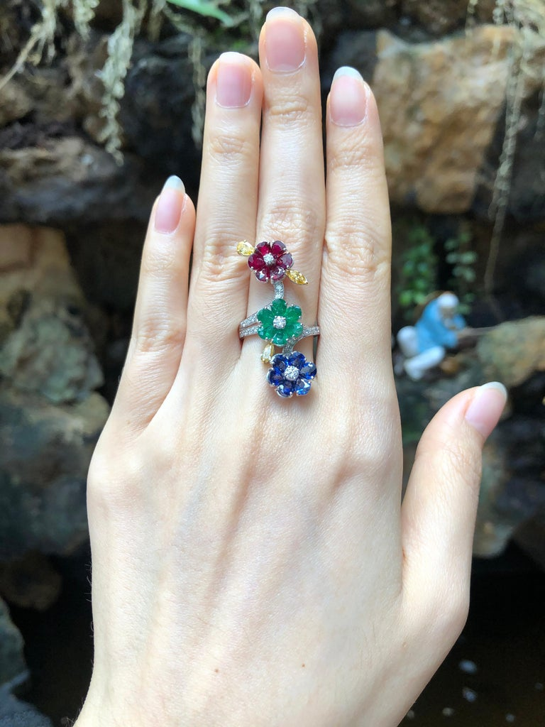 Ruby 1.45 carats, Blue Sapphire 1.92 carats, Emerald 1.27 carats with Yellow Diamond 0.45 carat and Diamond 0.46 carat Rings set in 18 Karat White Gold Settings  Width:  1.2 cm  Length: 3.8 cm Ring Size: 51 Total Weight: 8.29 grams