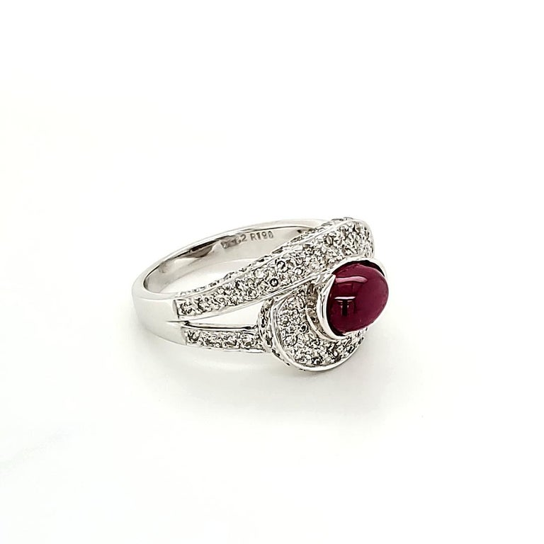 Ruby Cabochon And Diamond Ring:  An Intense Red Cabochon Ruby weighing 1.98 carat, with embellishment of White Diamonds on the shank weighing 0.63 carat. A simple design coupled with the fiery look of the Ruby makes the ring look elegant and