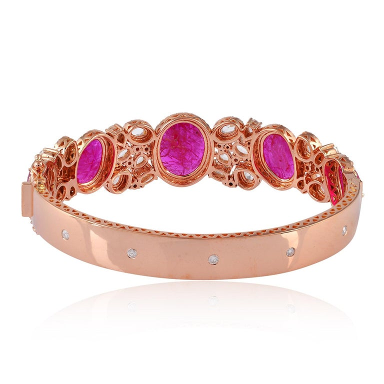 A beautiful bracelet handmade in 18 Karat Gold.  It is set in 10.2 carats ruby, 4.4 carats rose cut and pave diamonds.   FOLLOW  MEGHNA JEWELS storefront to view the latest collection & exclusive pieces.  Meghna Jewels is proudly rated as a Top
