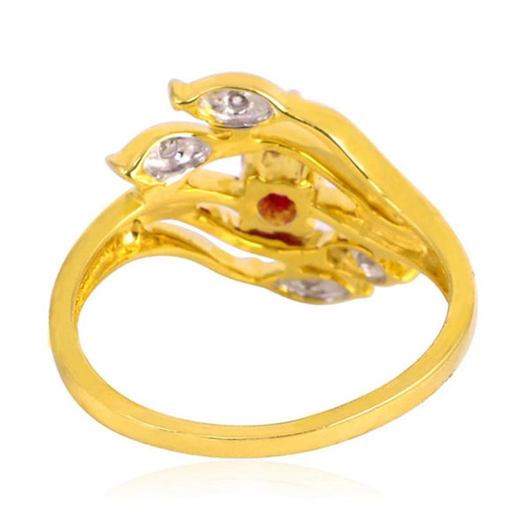 This ring has been meticulously crafted from 18-karat gold. It is hand set in .08 carats Ruby & .04 carats of sparkling diamonds.   The ring is a size 7 and may be resized to larger or smaller upon request.  FOLLOW  MEGHNA JEWELS storefront to view