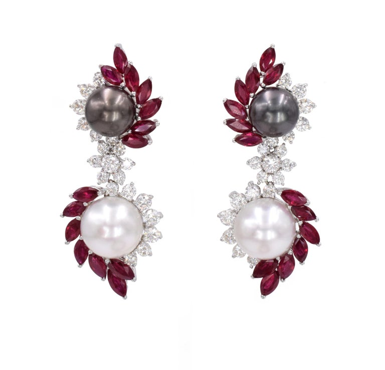 Ruby, Diamond, and Cultured Pearl Earrings This set has a bangle bracelet and pair of earrings. The bracelet has 317 rubies (pear shaped and round) with a total carat weight of approximately 21ct and 224 diamonds (round and square) with a total