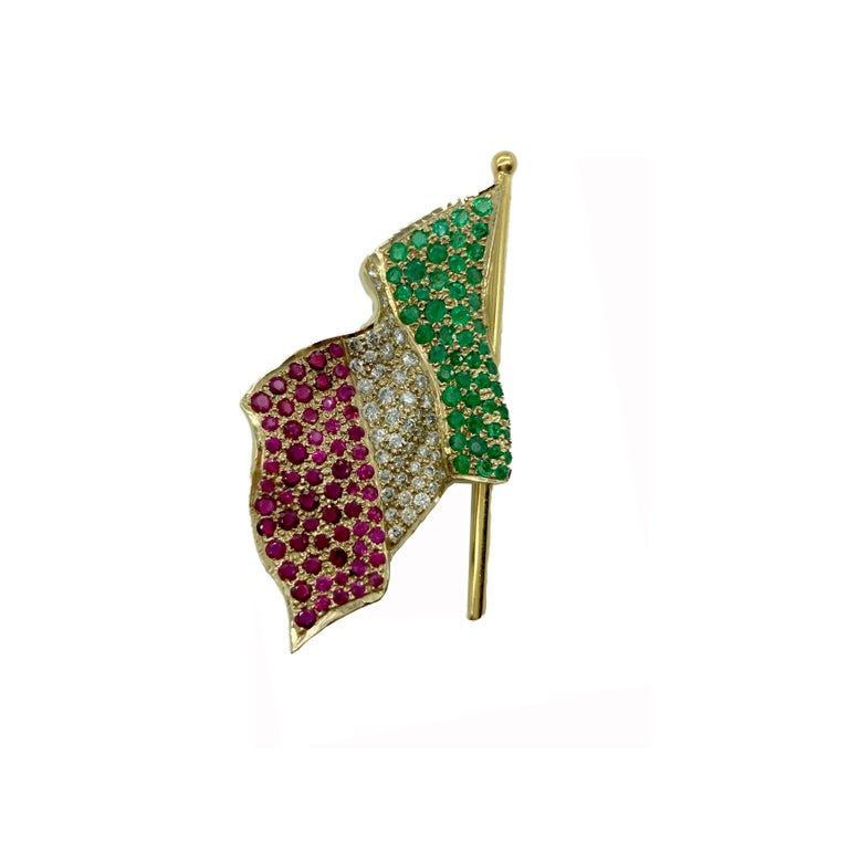 A chic Italian flag brooch encrusted in rubies, emeralds, and diamonds. Made in Italy.