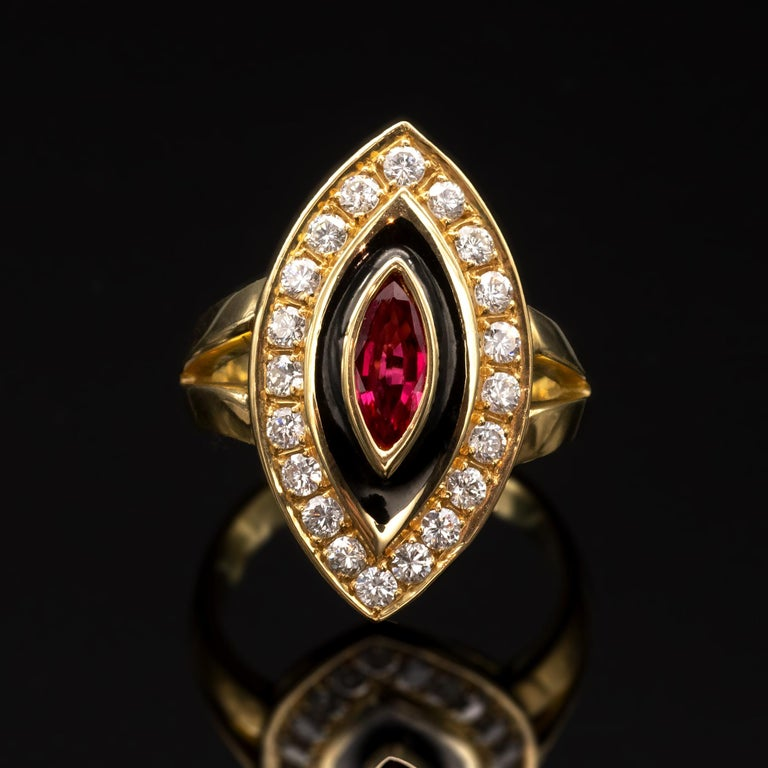 This marquise ring is a perfectly shaped combination of sharp, smooth lines and soft, rounded edges and sits perfectly flat. With an excellent make it is both simple and elegant, bearing a central ruby (approx 0.70ct) mounted alongside top-quality