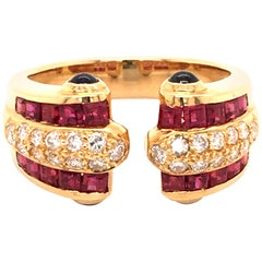 Ruby, Diamond and Sapphire Ring in 18 Karat Yellow Gold