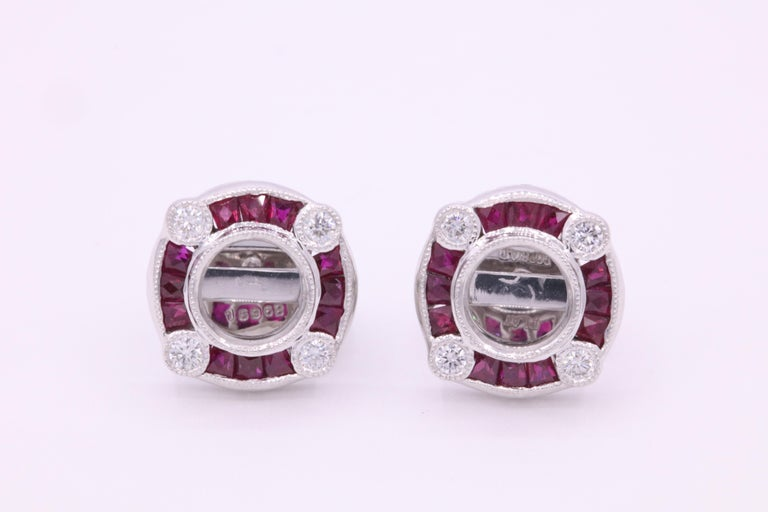 Art Deco inspired earring mountings featuring red rubies weighing 1.44 carats and round brilliants weighing 0.28 carats, crafted in platinum.   Harbor diamonds can mount your own diamond studs or gemstone.