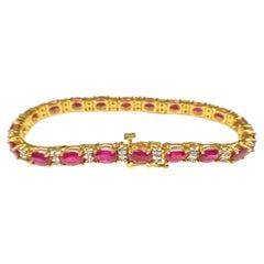 11 Carats Ruby Yellow Gold Bracelet Bangle